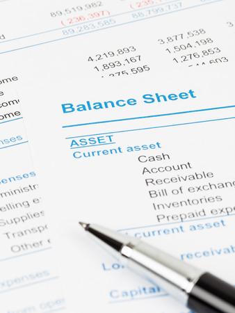 Balance sheet report; balance sheet is mock-up Stock Photo