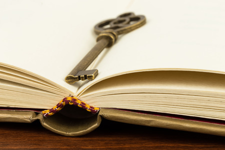 open bible: Antique key on book page