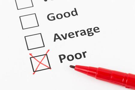 Customer satisfaction survey checkboxand pen with poor tick Stock Photo