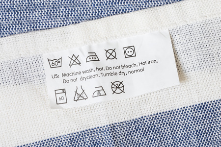 инструкция: Cloth label with laundry care instruction Фото со стока