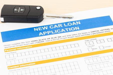 borrowing: Car loan application with car key; form is mock-up