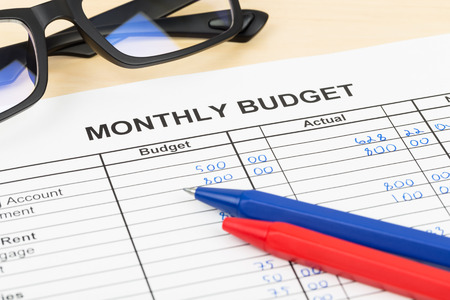 monthly salary: Home budget planning sheet with pen and glasses Stock Photo