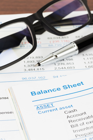 balance: Balance sheet in stockholder report book, balance sheet is mock-up