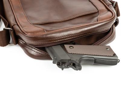 Messenger: Brown messenger bag with gun hidden