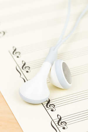 cream color: Earphone on  cream color paper music score