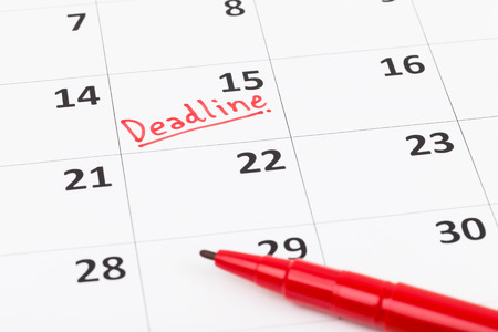 important: Calendar and deadline writen with red pen Stock Photo