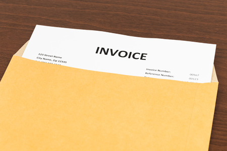 Invoice in envelope; invoice is mock-up Stock Photo
