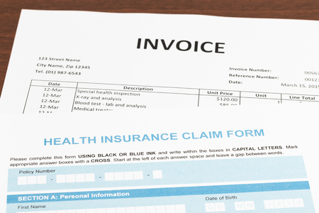 hospital expenses: Health insurance claim form and invoice; invoice and form are mock-up Stock Photo