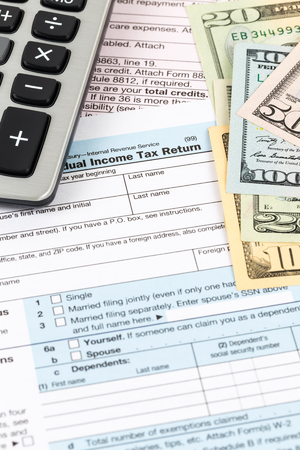 Tax form with calculator and banknote taxation concept Stock Photo