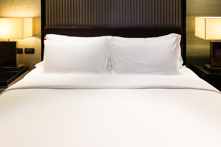 Luxury bed and pillow with light Foto de archivo