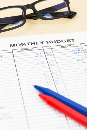 family budget: Home budget planning sheet with pen and glasses Stock Photo