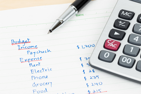 Hand writing home budget with calculator Stock Photo - 47966135