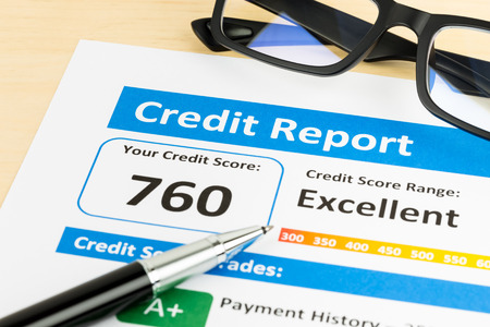 reports: Credit score report with pen, and glasses Stock Photo