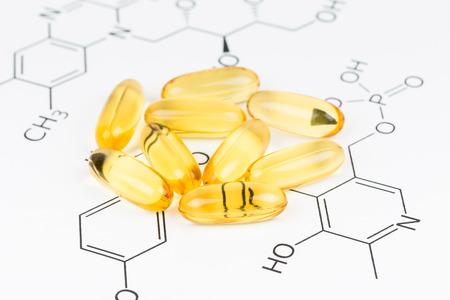 food supplement: Fish oil capsule food supplement on vitamin formula Stock Photo
