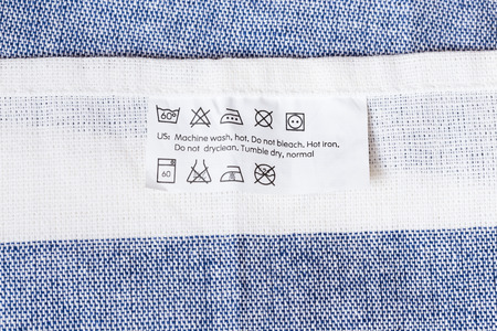 instruction: Cloth label with laundry care instruction Stock Photo