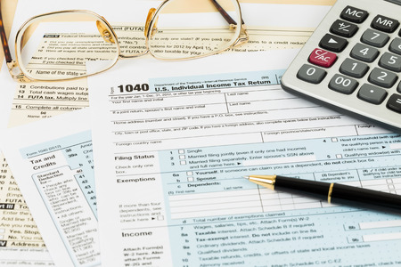 tax return: Tax form with glasses, and calculator Stock Photo