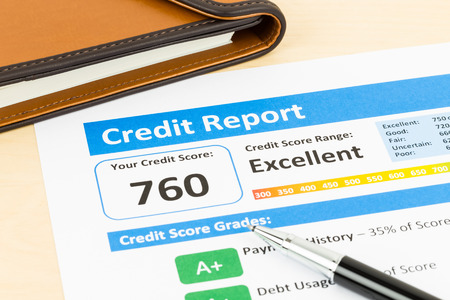 creditworthiness: Credit score report with pen and organizer book Stock Photo
