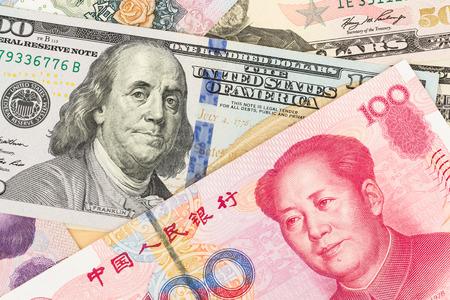 economia: Dólar y Yuan chino dinero de billetes