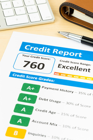 credit score: Credit score report with keyboard and pen
