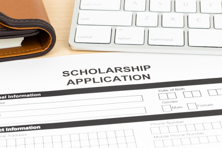 university application: Scholarship application form with keyboard