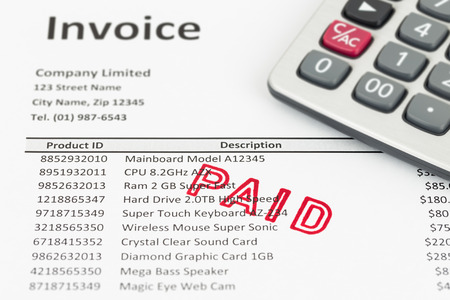 paid stamp: Invoice with paid stamp and calculator; invoice is mock-up