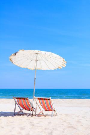 sun umbrella: Colorful wooden beach chairs with sun umbrella