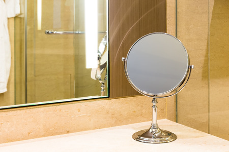 vain: Makeup mirror on marble counter bathroom