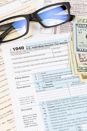Tax form with glasses, and banknote taxation concept Imagens