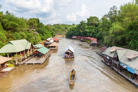 water fall: Kanchanaburi, THAILAND - Apr 12, 2015: Raft house resort near Sai Yok Yai waterfall on Khwae Noi River. Editorial
