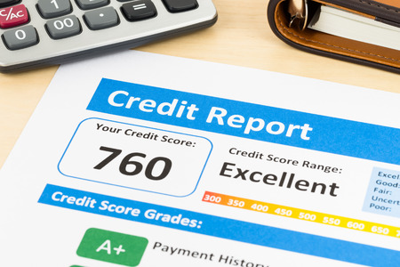 registros contables: Credit score report with calculator and organizer book