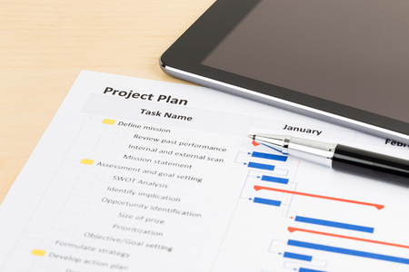gantt: Project management and gantt chart with tablet and pen Stock Photo