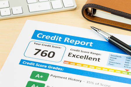 credit report: Credit score report with keyboard and pen