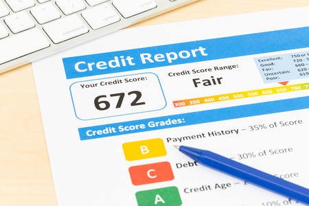credit report: Fair credit score report with pen and keyboard Stock Photo