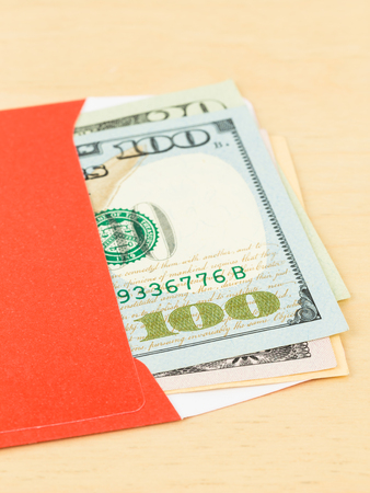 gift spending: Money dollar in red envelope