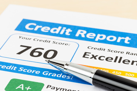 credit score: Credit score report with pen Stock Photo