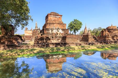 maha: Buddha statue and pagoda in Wat Maha That, Shukhothai Historical Park, Thailand