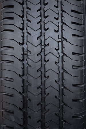 Tyre tread textured car wheel close-up
