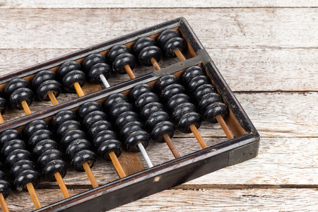 calculator chinese: Old abacus on wooden background