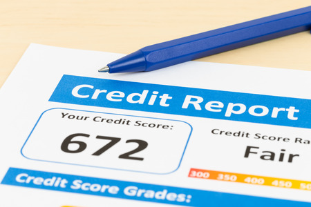 creditworthiness: Fair credit score report with pen