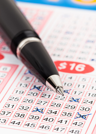 lotto: Lotto ticket gambling with pen, ticket is mock-up