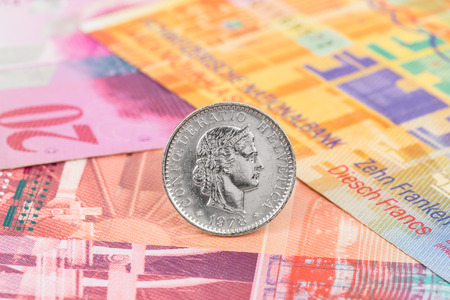 swiss franc note: Switzerland coin swiss franc stand on banknote money Stock Photo