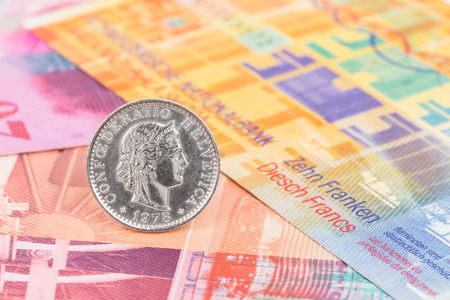franc: Switzerland coin swiss franc stand on banknote money Stock Photo