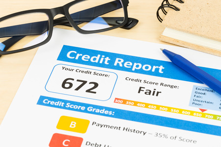 moderate: Fair credit score report with pen