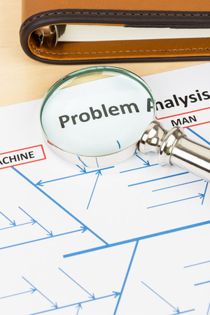 cause and effect: Problem solving using cause and effect or fishbone diagram with magnifier and organizer Stock Photo