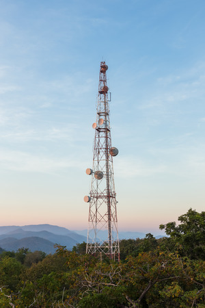hill station tree: Communication tower antenna on mountain at twilight Stock Photo