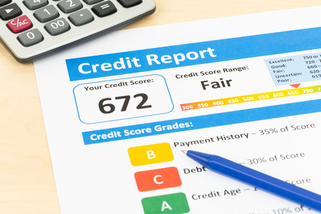 score: Fair credit score report with pen and calculator