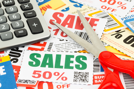 frugal: Saving discount coupon voucher with scissor and calculator, coupons are mock-up