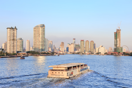 urbanscape: Bangkok, Thailand - January 2, 2016: River cruise in Chao phraya river, and Bangkok cityscape near twilight Editorial