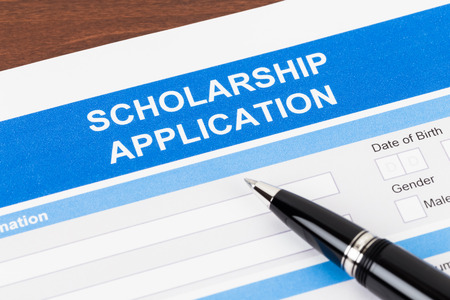 scholarship: Scholarship application form with pen