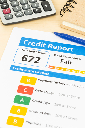 credit report: Fair credit score report with pen and calculator; report is mock-up Stock Photo